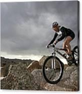 Female Rider Mountain Biking Between Canvas Print