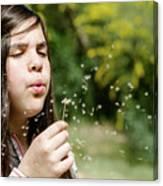 Girl Blowing Dandelion Flower Canvas Print