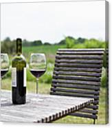 Glasses And A Bottle Of Red Wine On An Canvas Print