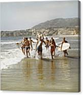 Group Of Surfers Running In Water With Canvas Print