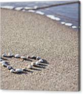 Heart Made Of Pebbles On Sand Canvas Print