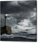 Lighthouse Shining Over Stormy Ocean Canvas Print