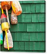 Lobster Buoys Hanging On A Green Wood Canvas Print