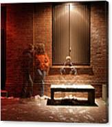 Man And Woman Leaning Against A Brick Canvas Print