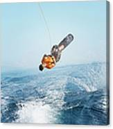 Man Performing Wakeboarding Stunt At Sea Canvas Print