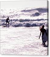 Man Surfing On Sea, Woman Walking With Canvas Print