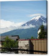 Mount Fuyji From A Distance With Clouds Around It Canvas Print