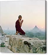 Myanmar, Bagan, Buddhist Monk Praying Canvas Print