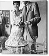 Newlyweds Cutting Wedding Cake Canvas Print