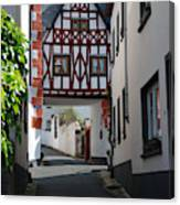 old historic street and woodframed house in Ediger Germany Canvas Print