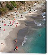 People Relax On Shell Beach Canvas Print