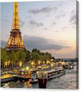 Portrait View Of The Eiffel Tower At Night With Wine Glass In The Foreground Canvas Print