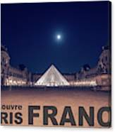 Poster Of  The Louvre Museum At Night With Moon Above The Pyrami Canvas Print