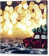 Red Car With Christmas Tree Driving Through Snow Canvas Print