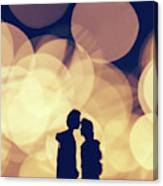 Romantic Couple Kissing On Illuminated Background. Canvas Print