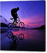 Silhouette Of A Mountain Biker On Beach Canvas Print