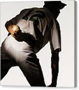 Silhouette Of Baseball Pitcher Holding Canvas Print
