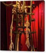Skeleton  In Torturedevise Canvas Print
