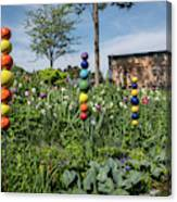 Sticks With Colorful Balls In A Garden Canvas Print