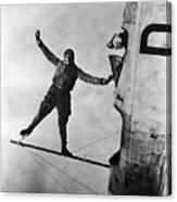 Stunt Flier Suspended Over Cockpit Canvas Print