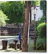 tree lamp and old water pump in Cochem Germany Canvas Print