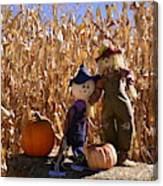 Two Cute Scarecrows With Pumpkins In The Dry Corn Field Canvas Print