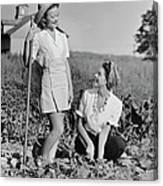 Two Women Gardening In Field Canvas Print