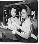 Two Women In Workshop Looking At Canvas Print