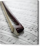 Violin Bow On Music Sheet Canvas Print