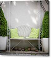 White Bench Made Of Iron With Two Green Bushes On The Side Canvas Print