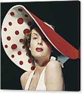 Woman Wearing Large Spotted Hat Canvas Print
