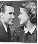 Young Couple Looking In Eyes In Studio Canvas Print