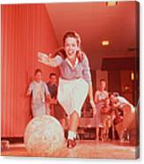 Young Woman Bowling, Family Watching In Canvas Print