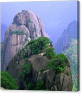A Rocky Outcropping Overlooks A Mist-covered China Mountain Range Canvas Print