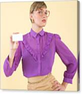A woman holding a business card Canvas Print