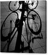 Bicycle shadow Canvas Print