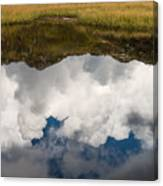Clouds and mountains reflecting in mountain lake Canvas Print