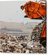 Garbage truck dumping the garbage Canvas Print