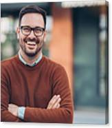 Smiling man outdoors in the city Canvas Print