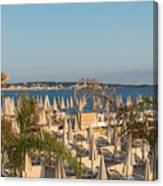 Umbrellas and beach chairs on the beach, Cannes, French Riviera Canvas Print