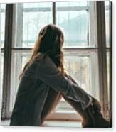 Woman Looking Through Window Canvas Print
