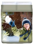 A Boy Throws A Snowball While Playing Duvet Cover