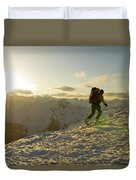 A Man Backcountry Skiing At Sunset Duvet Cover