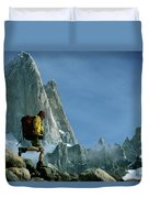A Man Backpacks In Front Of Fitz Roy Duvet Cover