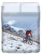 A Mountain Biker Rides Through The Snow Duvet Cover