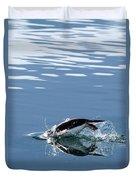 A Penguin Swims Through The Clear Duvet Cover