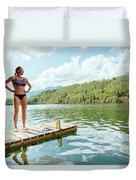 A Woman Is Standing On A Jetty Duvet Cover