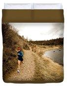 A Woman Jogging On A Dirt Trail Duvet Cover