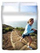 A Woman Running Stairs Near The Ocean Duvet Cover