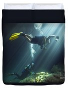 A Young Married Couple Scuba Diving Duvet Cover by Michael Wood